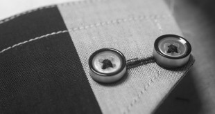 Close-up of seam and buttons on a jacket